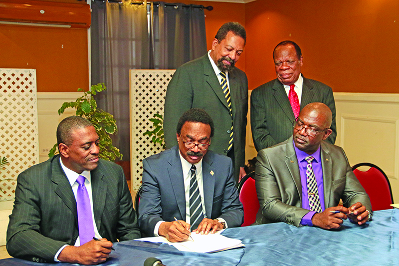 Attorney General Basil Williams and representatives of UCC/LCA signing the Memorandum of Understanding for the establishment of the law school in Guyana